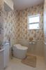 岡崎市注文住宅 A様邸 広々とした1階トイレ。手洗いやアームレストなどの快適装備も満載です。