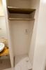 名古屋市リノベーション 実例A 洗濯機用のパンを設けた選択コーナー。上部に棚を設けて有効利用しています。