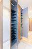 名古屋市リノベーション 実例A 壁一面に設置した玄関収納。靴だけでなく日用品の収納にも対応します。