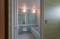 ミントグリーンのかわいらしい浴室。